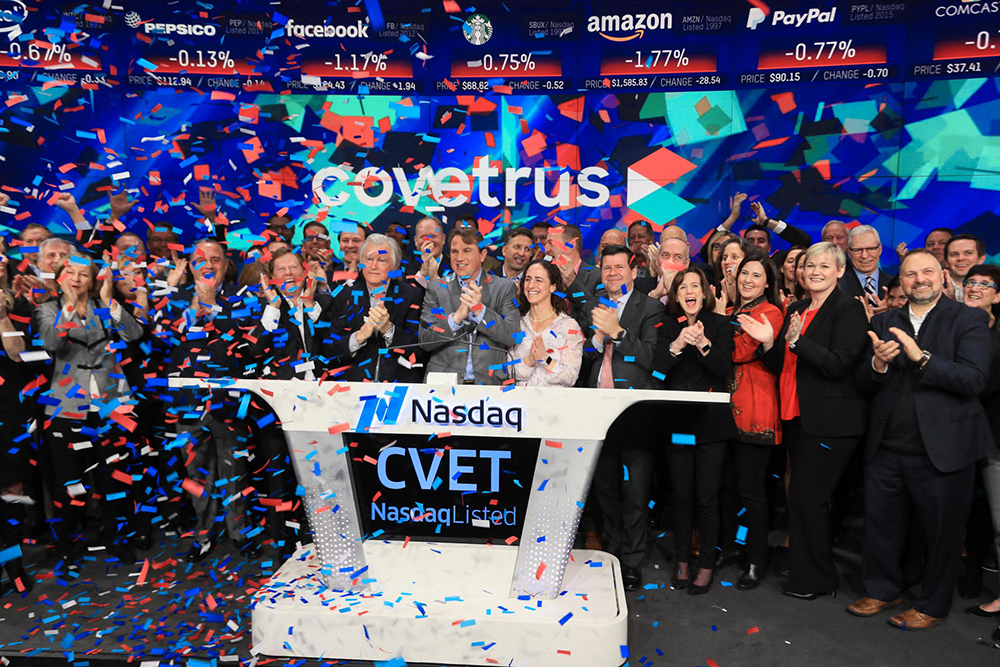 Benjamin Shaw, president and CEO of Covetrus Inc., celebrates the listing of its stock Friday by ringing the opening bell of the Nasdaq stock exchange in New York's Times Square.