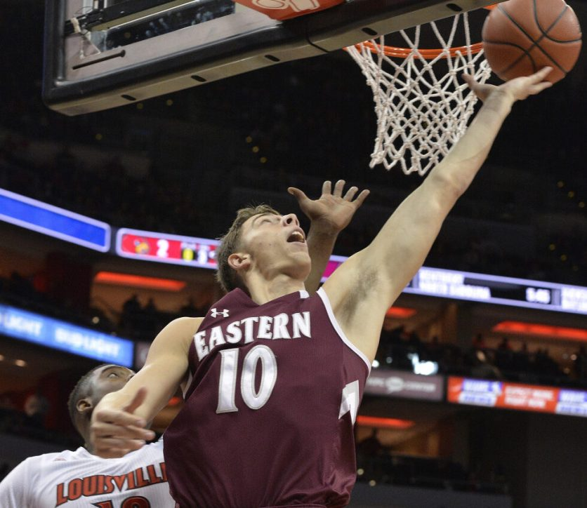 Eastern Kentucky's Nick Mayo (10) shoots past the defense of Louisville's Jaylen Johnson (10) during the first half of an NCAA college basketball game, Saturday, Dec. 17, 2016, in Louisville, Ky. (AP Photo/Timothy D. Easley)
