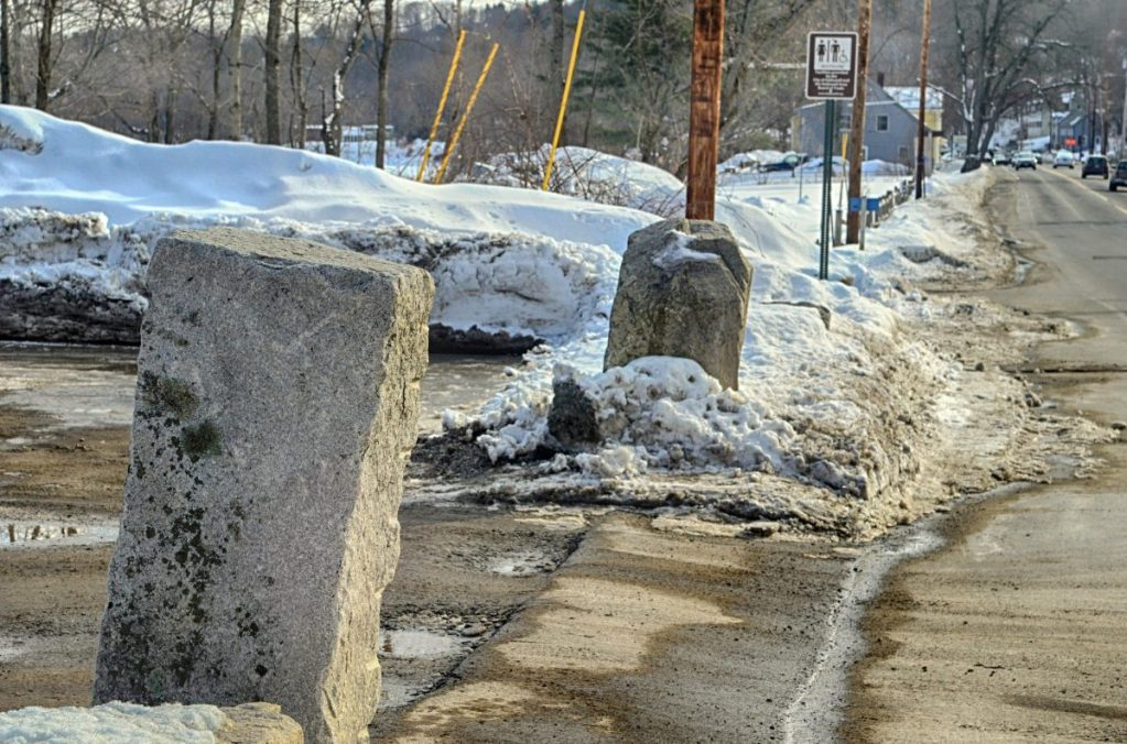 Kennebec Journal photo by Joe Phelan The stone blocks flanking the Lucky Garden restaurant parking lot driveway in Hallowell. The state boat launch is seen in the background farther south on Water Street.