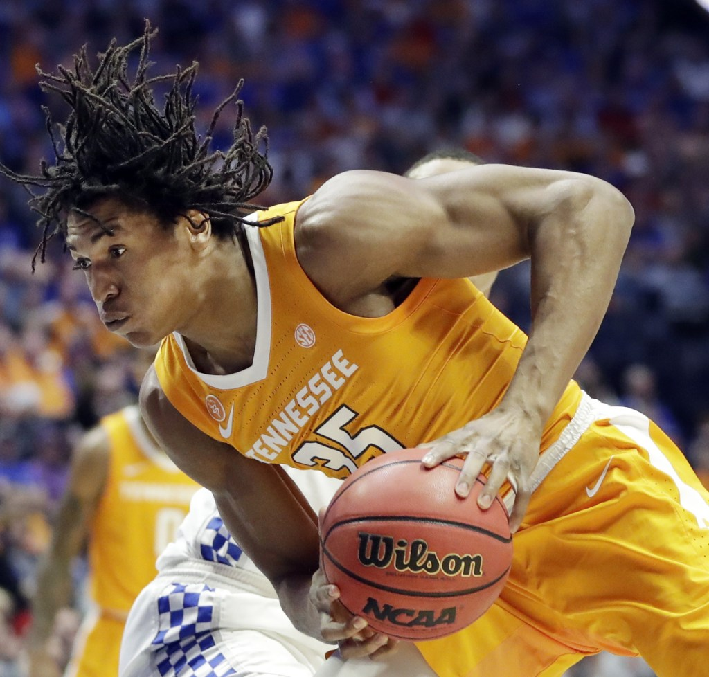 Tennessee forward Yves Pons drives against Kentucky in the first half of an NCAA college basketball game at the Southeastern Conference tournament Saturday, March 16, 2019, in Nashville, Tenn. ()