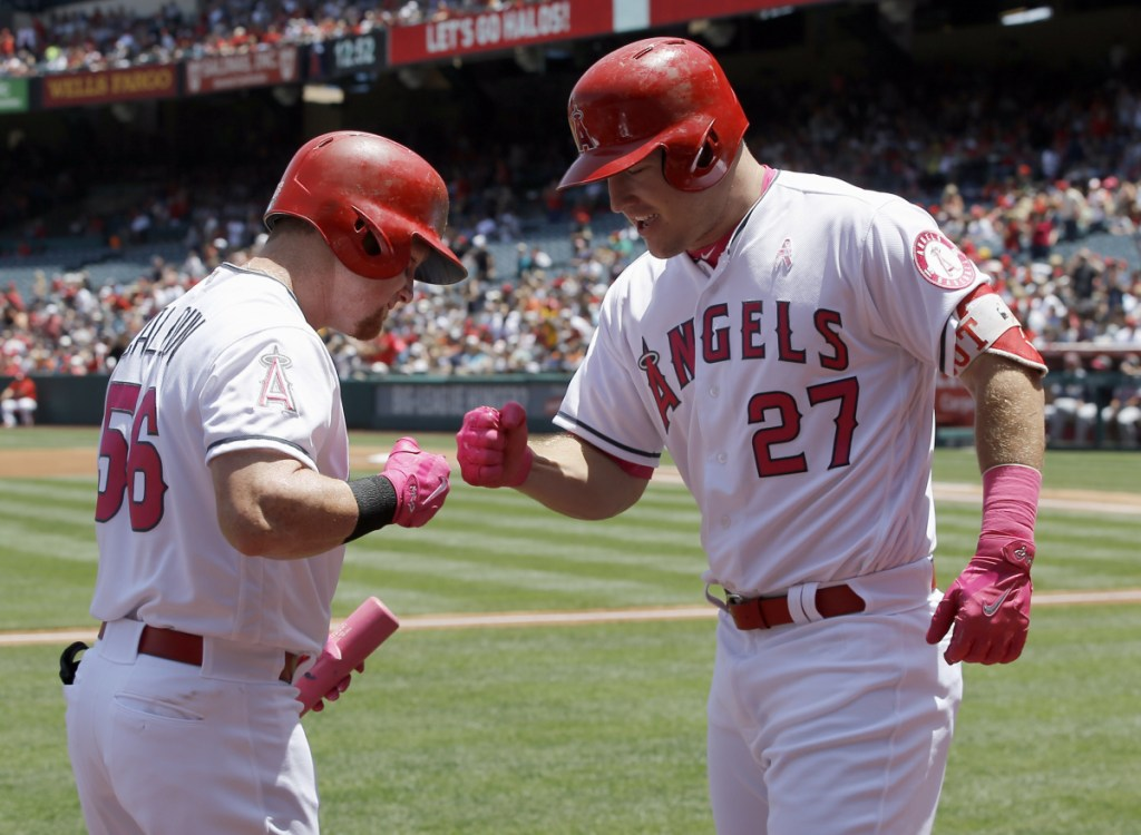 Los Angeles' Mike Trout, right, shown celebrating with Kole Calhoun after hitting a home run in May 2017, is working on a $430 million contract extension with the Angels. (AP Photo/Alex Gallardo)