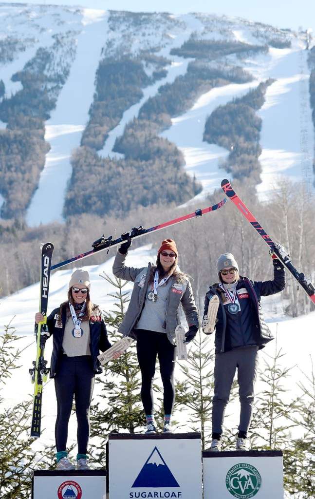 Alice Merryweather, center, won the women's downhill championship Tuesday at Sugarloaf. Keely Cashman, right, came in second and AJ Hurt, left, took third. Story, Page D5