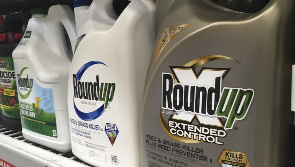 Containers of Roundup are displayed on a store shelf in San Francisco in February. Bayer maintains its weedkiller's active ingredient does not cause cancer.