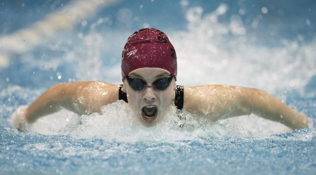 Olivia Tighe has led Cape Elizabeth to three straight Class B state titles, setting two individual state records and three relay state records.