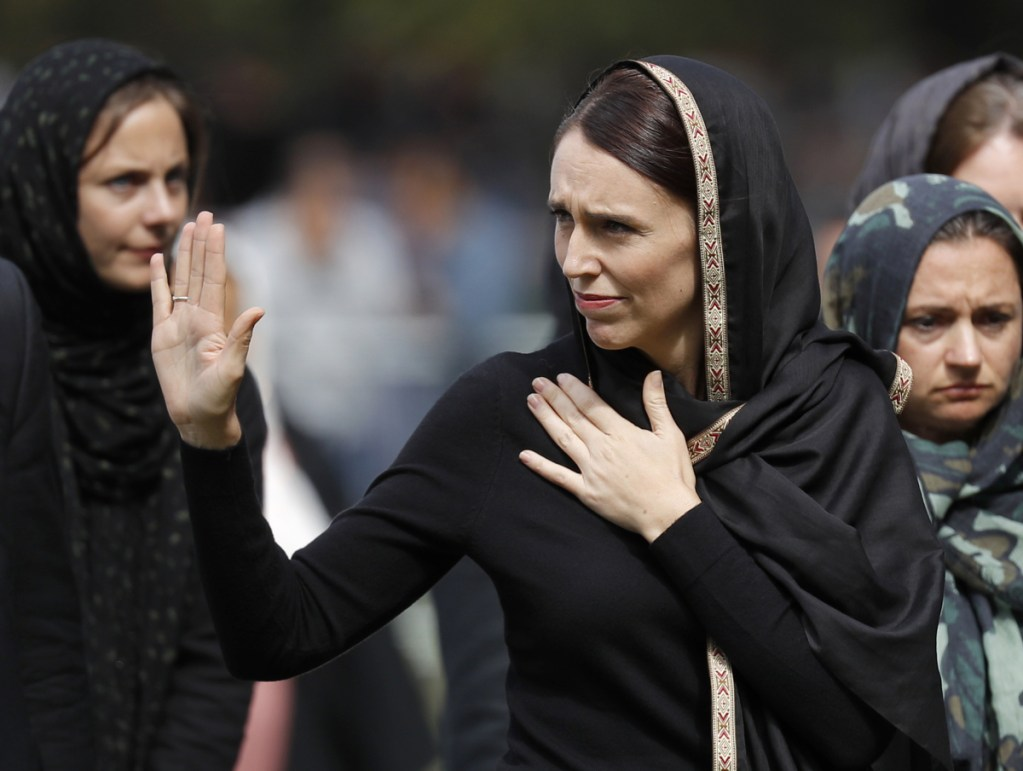 New Zealand Prime Minister Jacinda Ardern waves as she leaves Friday prayers at Hagley Park in Christchurch, New Zealand. People across New Zealand observed the Muslim call to prayer Friday as the nation reflected on the moment a week ago when 50 people were slaughtered at two mosques.