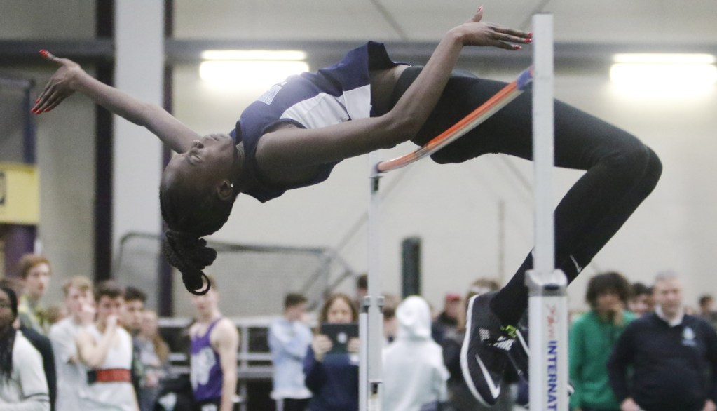 Nyagoa Bayak became the first Maine girl to clear 6 feet in the high jump, and went on to win the Class A and New England titles for a fourth straight year.