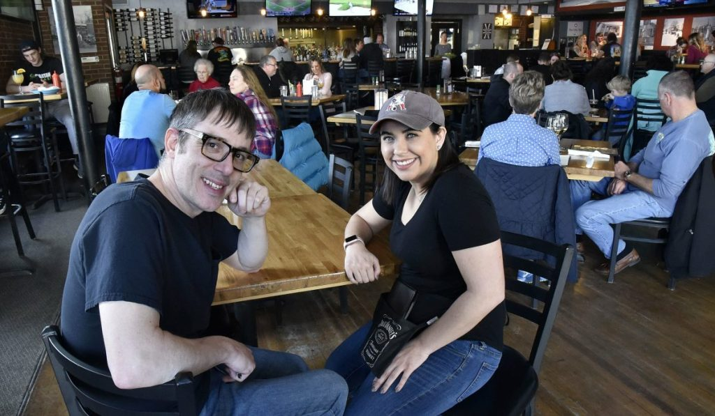 Silver Street Tavern employees Zack Denis and Samantha Clark take a break from serving customers Sunday to talk about the unprecedented $2,000 tip they and other employees will split from an anonymous customer at the Waterville restaurant Saturday.