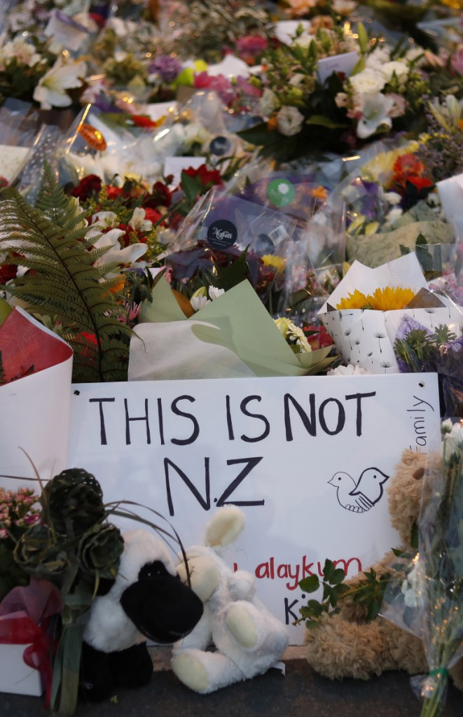 Flowers lie at a memorial near a Christchurch, New Zealand, mosque. New Zealanders are debating the limits of free speech after their chief censor banned a manifesto written by the massacre suspect.