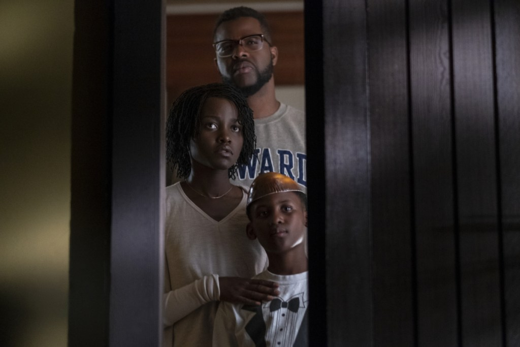 "Winston Duke, Lupita Nyong'o and Evan Alex in a scene from ""Us,"" written, produced and directed by Jordan Peele."