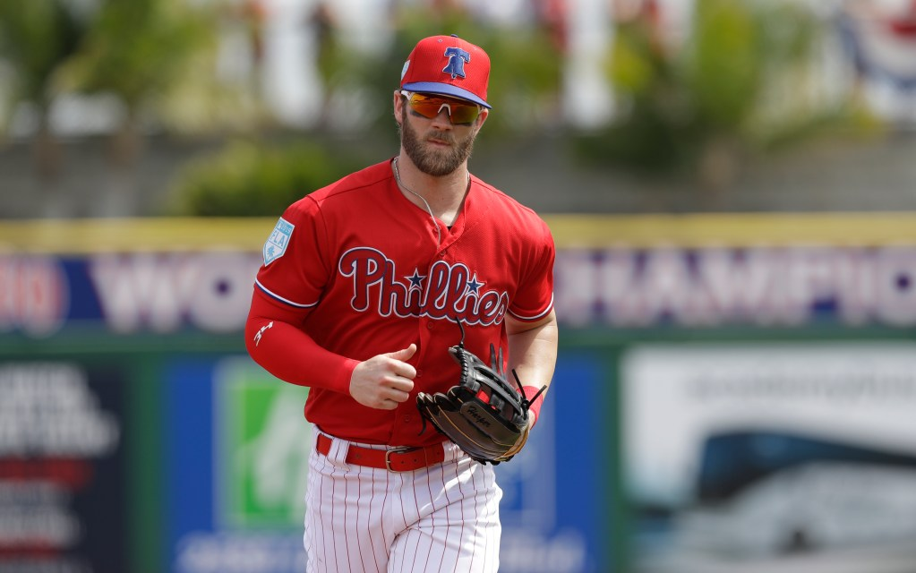 Bryce Harper played in the outfield for the first time in a Philadelphia Phillies uniform on Monday against the Tampa Bay Rays in Clearwater, Florida.