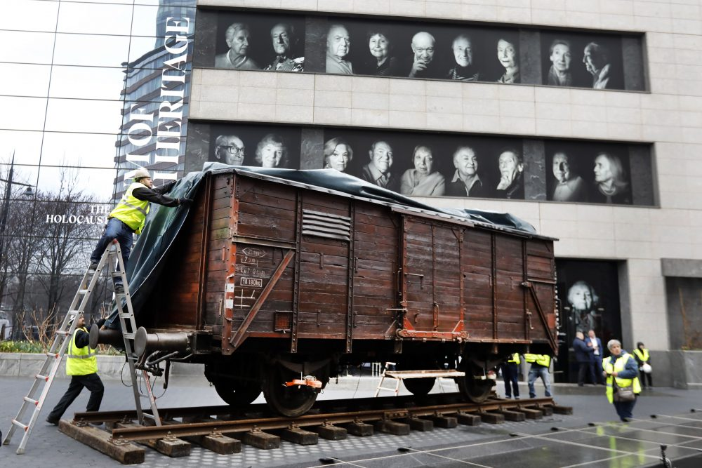 A train car similar to those that were used to transport the Holocaust's victims to concentration camps arrives at the Museum of Jewish Heritage on Sunday.