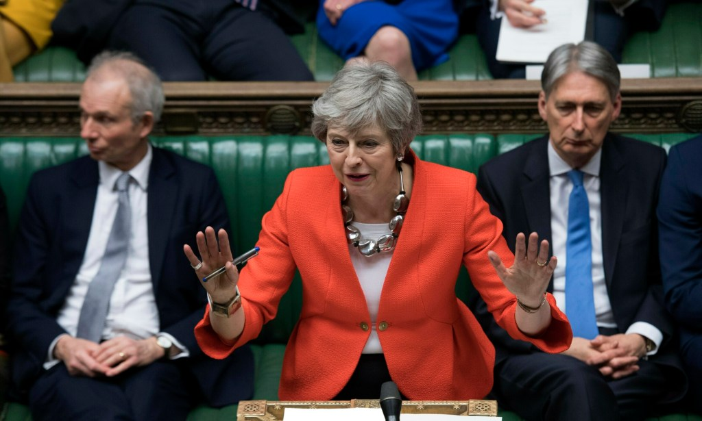 Britain's Prime Minister Theresa May speaks to lawmakers in Parliament this month. She said Wednesday she would step down as prime minister once this phase of Brexit is concluded.