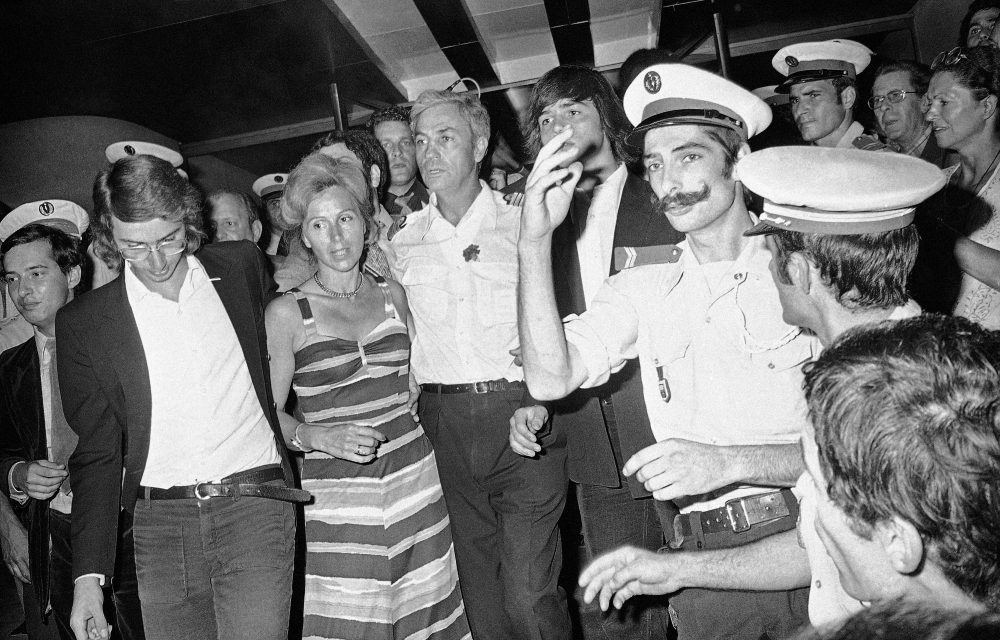 Pilot Michel Bacos, center left, is reunited with his wife, second left, and son at Orly Airport near Parisin 1976.