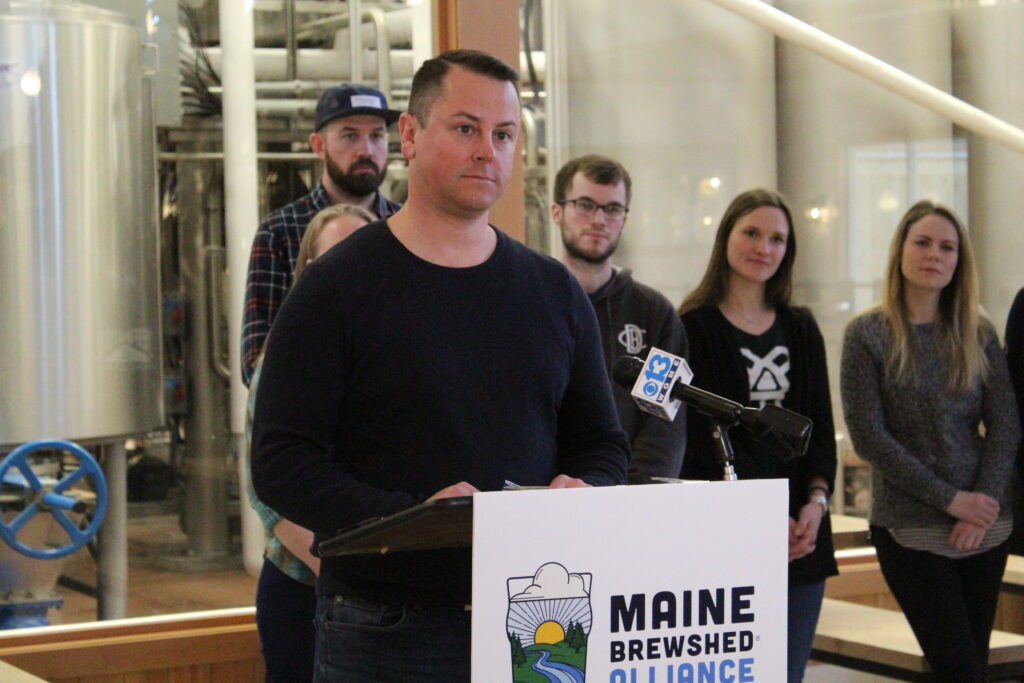 """Dan Kleban, founder of Maine Beer Company, urges other brewers to help protect the state's waterways because """"once it reaches a tipping point it's very hard to go back,"""" he said at a news conference Wednesday."""