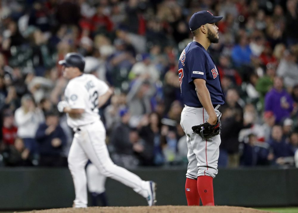 Boston Red Sox starting pitcher Eduardo Rodriguez, right, looks away as Seattle Mariners' Jay Bruce rounds the bases after his three-run home run in the fifth inning  Saturday night in Seattle.