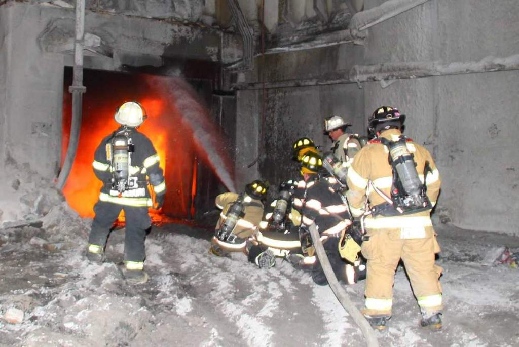 Fire crews work to extinguish flames at a building at Dragon Products on Wednesday night.