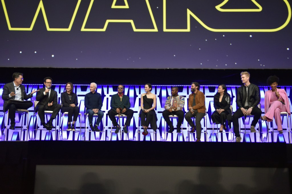 "Stephen Colbert, from left, J.J. Abrams, Kathleen Kennedy, Anthony Daniels, Billy Dee Williams, Daisy Ridley, John Boyega, Oscar Isaac, Kelly Marie Tran, Joonas Suotamo and Naomi Ackie participate in the ""Star Wars: The Rise of Skywalker"" panel on day 1 of the Star Wars Celebration at Wintrust Arena on Friday, April 12, 2019, in Chicago. (Photo by Rob Grabowski/Invision/AP)"