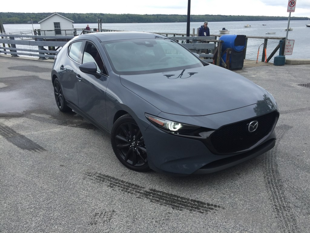 Mazda 3 prices range from $19,000 for base sedans to $31,335 for the Premium AWD Hatch reviewed. Photo by Tim Plouff. Location: Cousins Island ferry dock, Yarmouth.