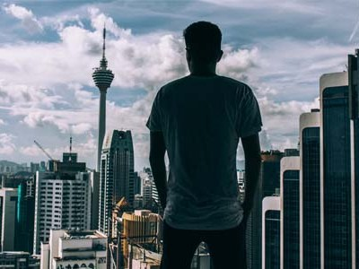 Man looking over cityscape