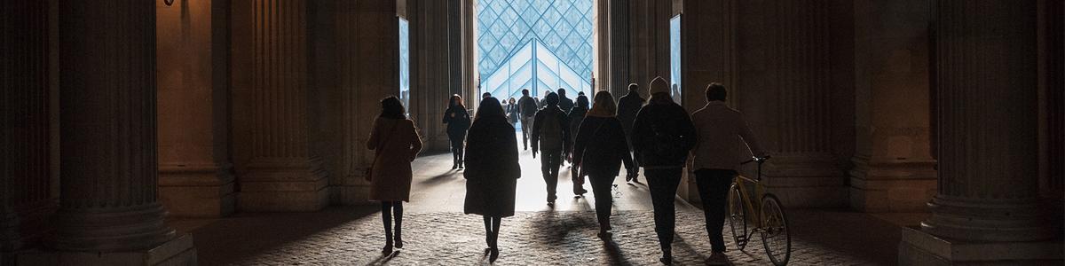 People going towards an open hallway