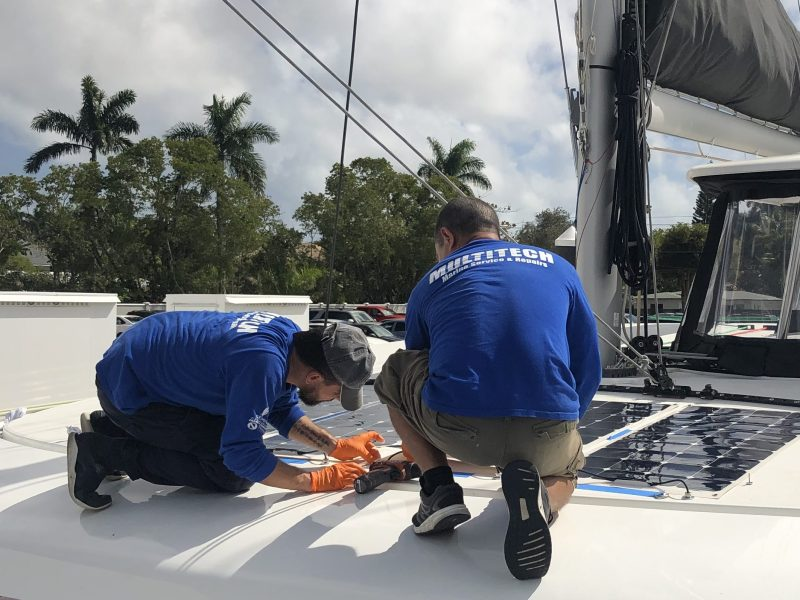 Multitech Technicians Installing Solar Panels on Catamaran