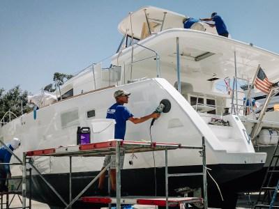Multitech Team performing detailing work on a catamaran