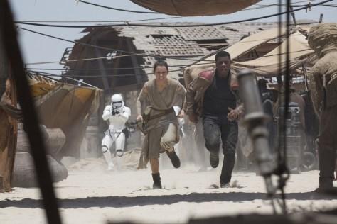 Star Wars: The Force Awakens..L to R: Rey (Daisy Ridley) and Finn (John Boyega)..Ph: David James..©Lucasfilm 2015