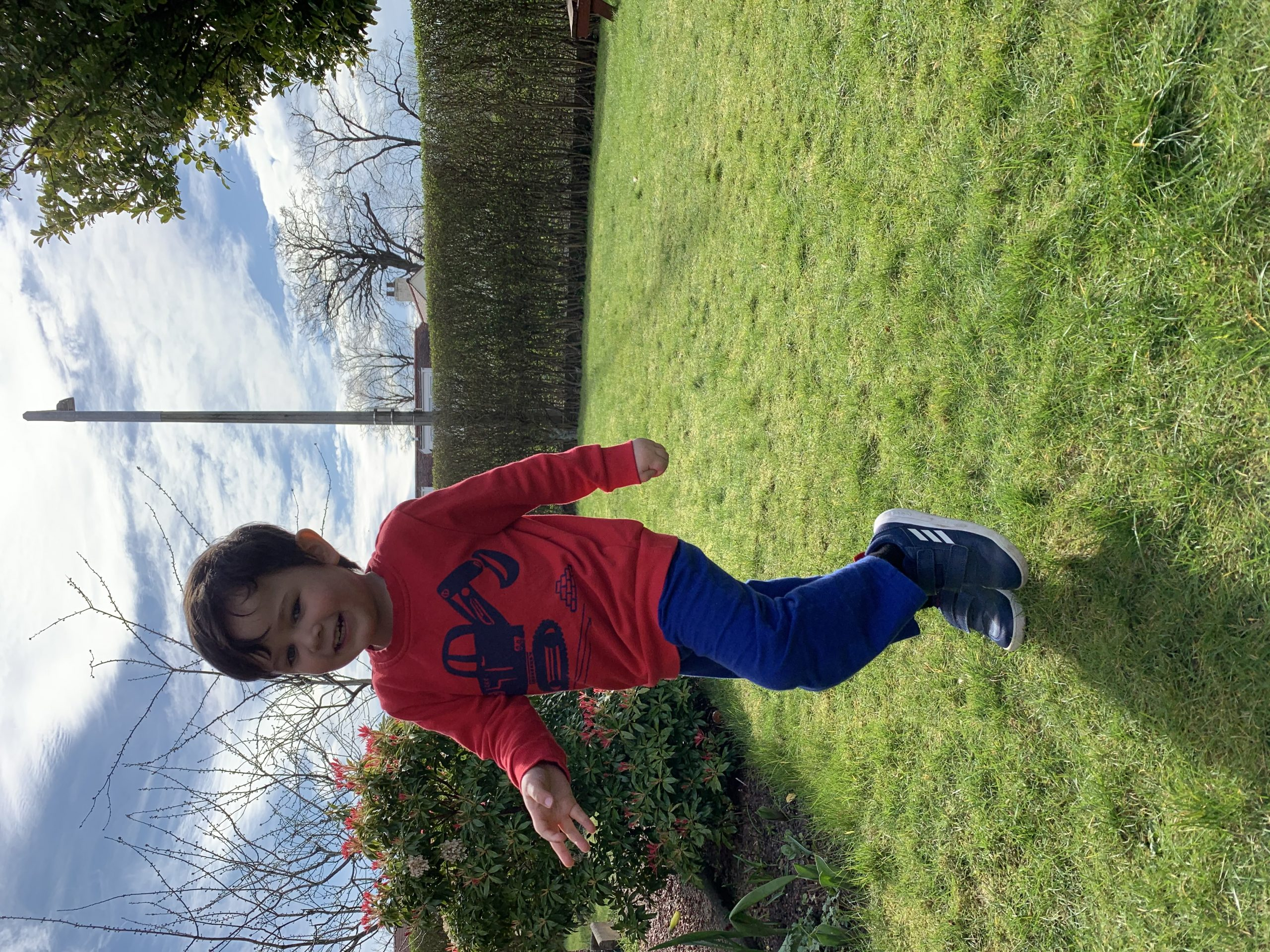 boy in red jumper in a garden covid19 diary