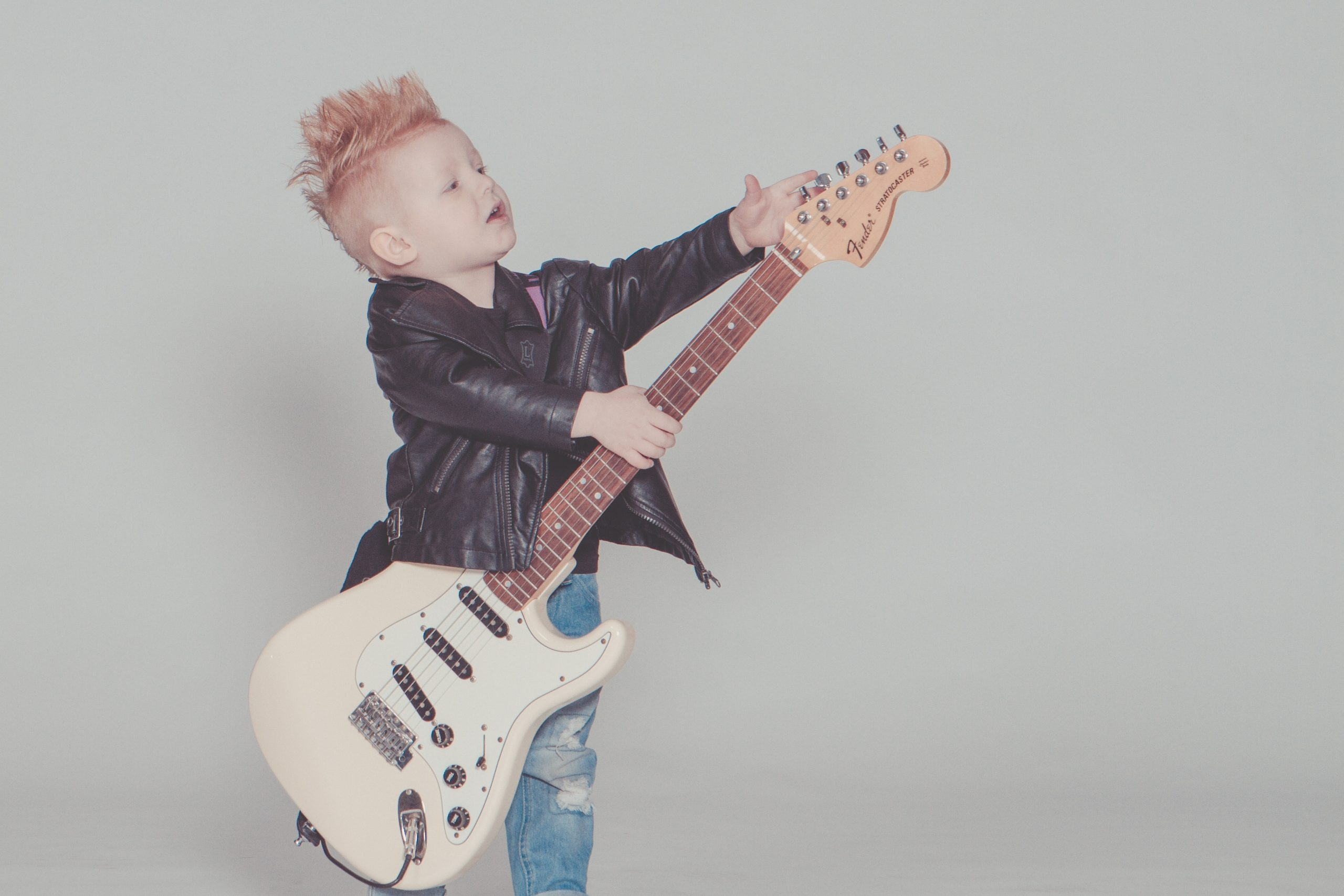 young boy with a electric guitar