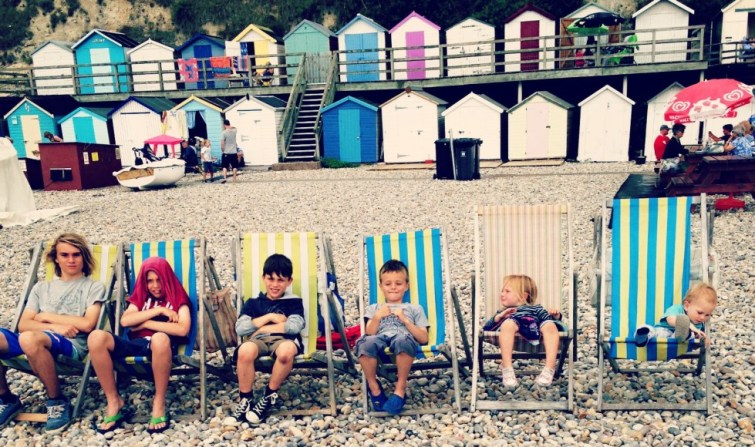 capturing families in restaged photos, this one is restaged every year on a beach in Devon