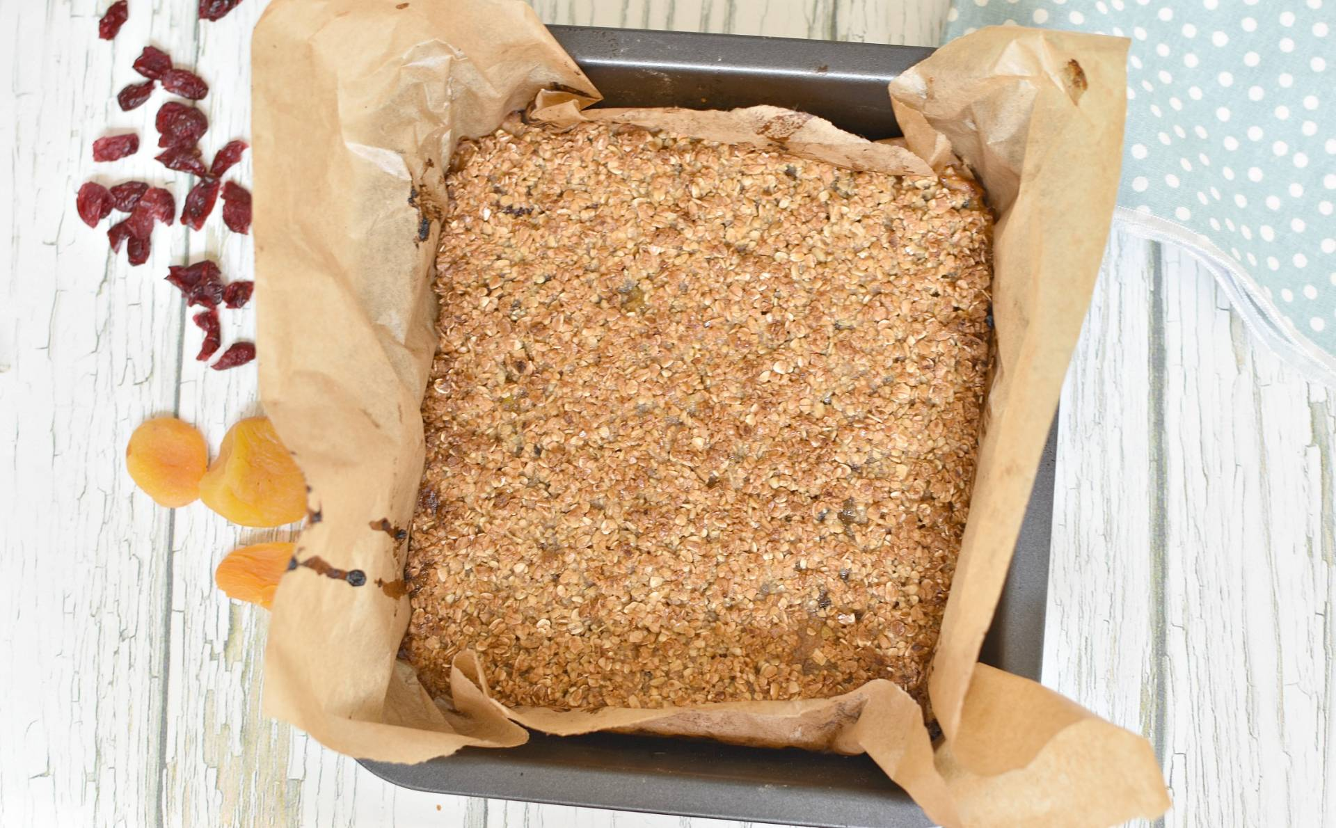 apricot, apple & cranberry oat bars . delicious, tasty and healthy snack which will fill you up and are perfect for picnics and lunch boxes