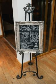 winter wedding order of service blackboard and silver frame