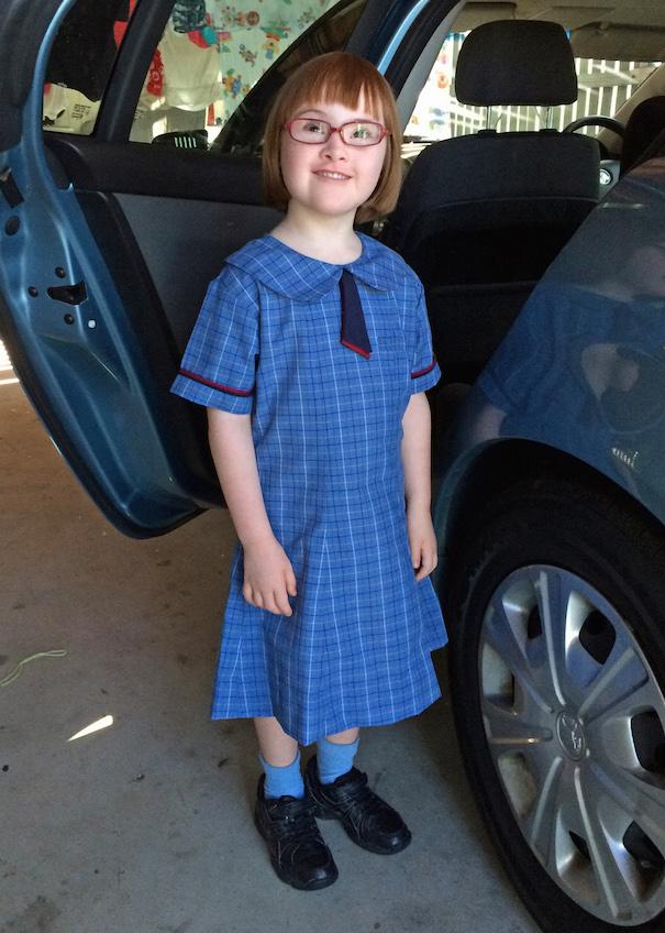 Too cute in her Catholic school girl dress