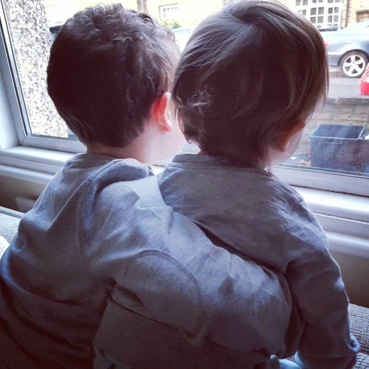 brothers-looking-out-window
