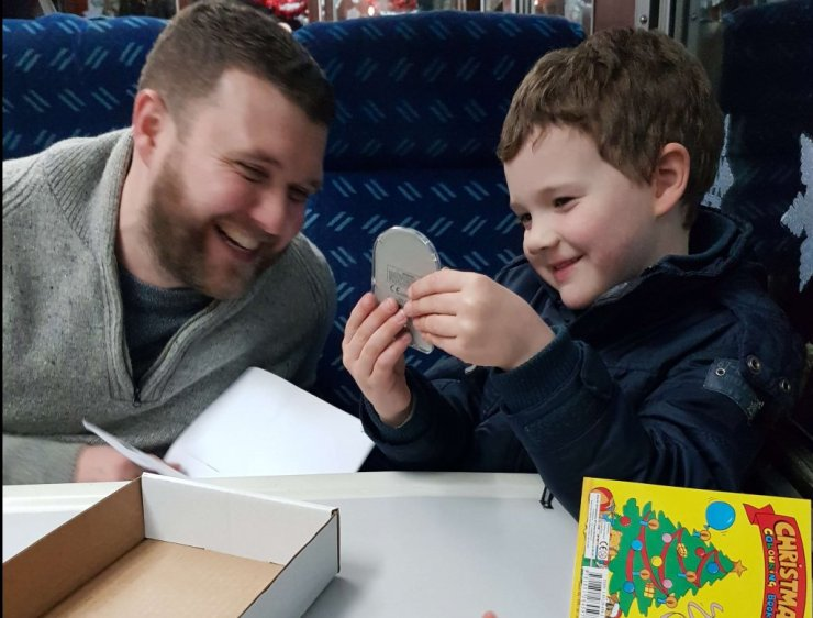 boy-and-dad-playing-on-train
