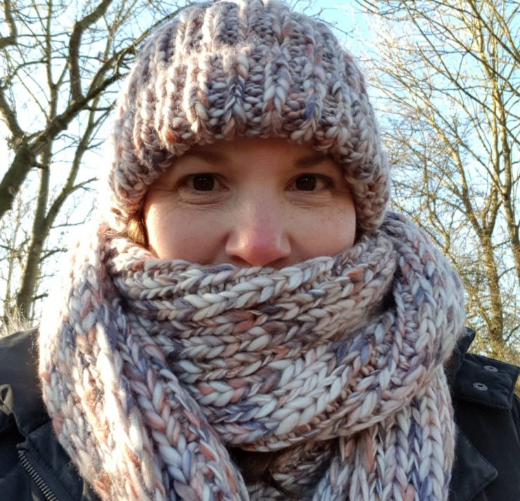 woman-in-cold-country-park-wearing-big-scarf-and-wooly-bobble-hat