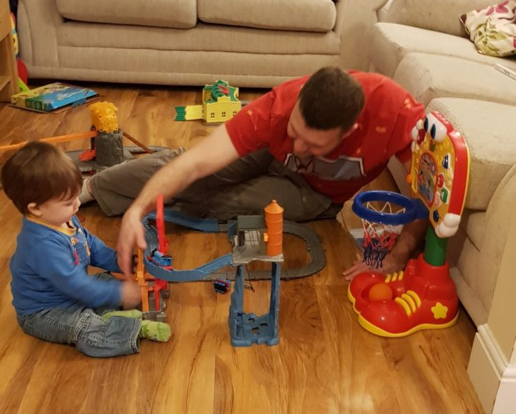 toddler-and-his-dad-playing-with-thomas-the-tank-engine-set