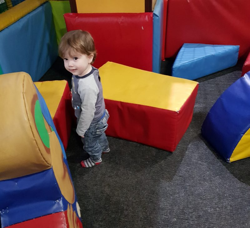 toddler-in-soft-play-looking-happy