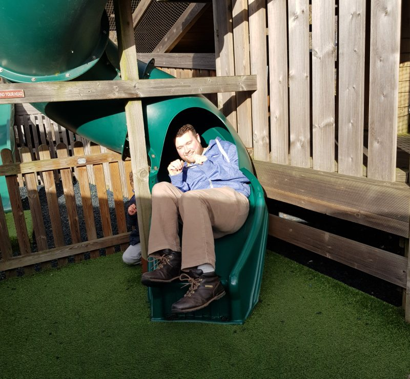 man-coming-out-of-tunnel-slide