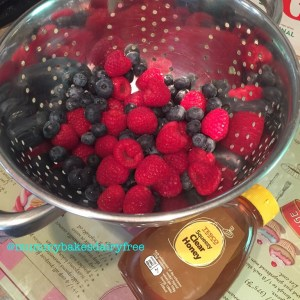 All you need is raspberries, blueberries and honey.