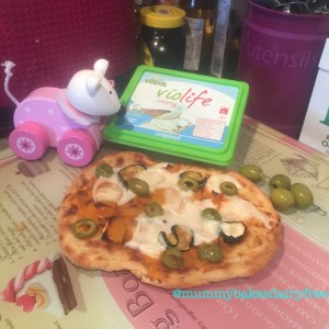 Homemade pizza with Violife and olive topping