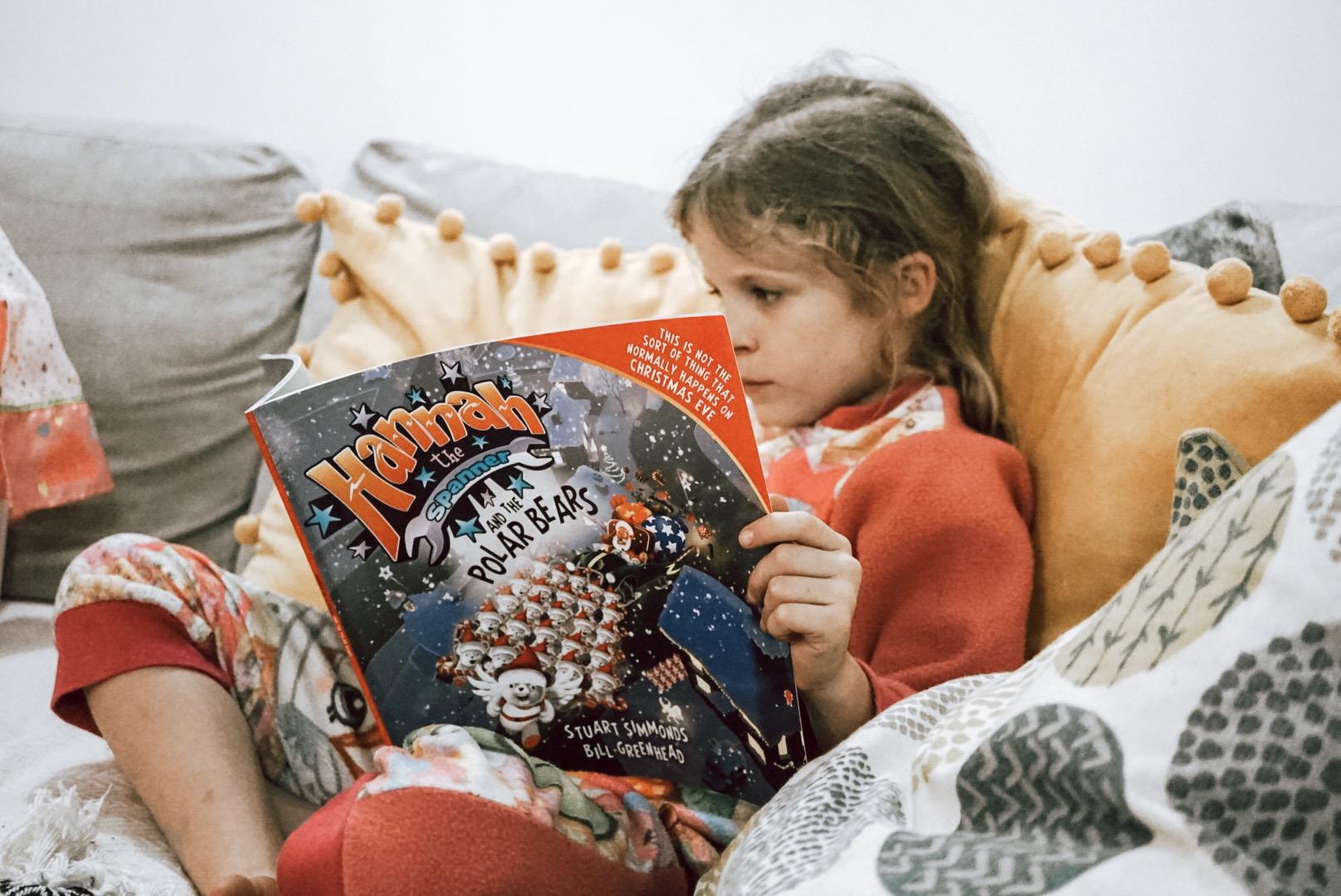 Isla reading a book