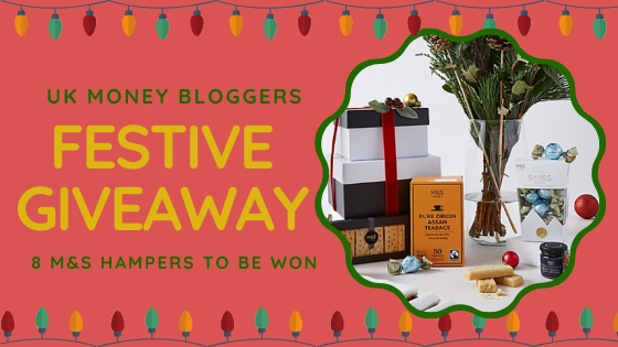 Text reads: FEstive Giveaway - win 1 of 8 hampers with a picture of some M&S hampers