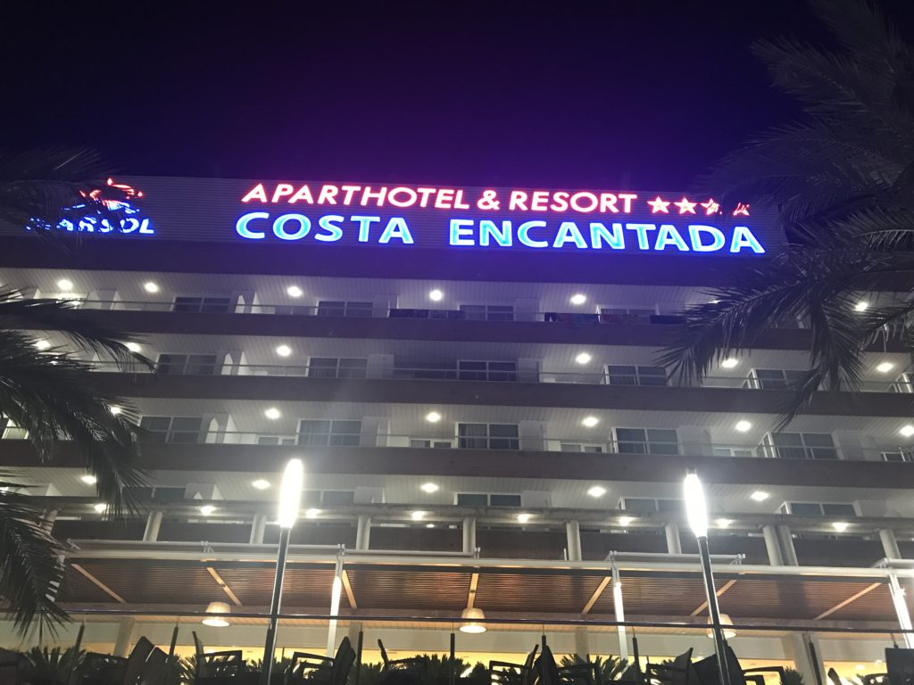 a view of the front of the costa encantada hotel by night