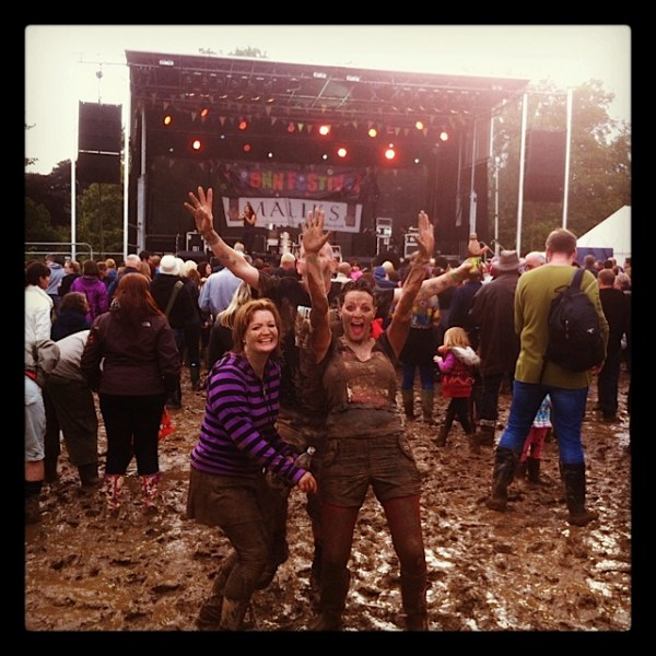 people covered in mud at music festival