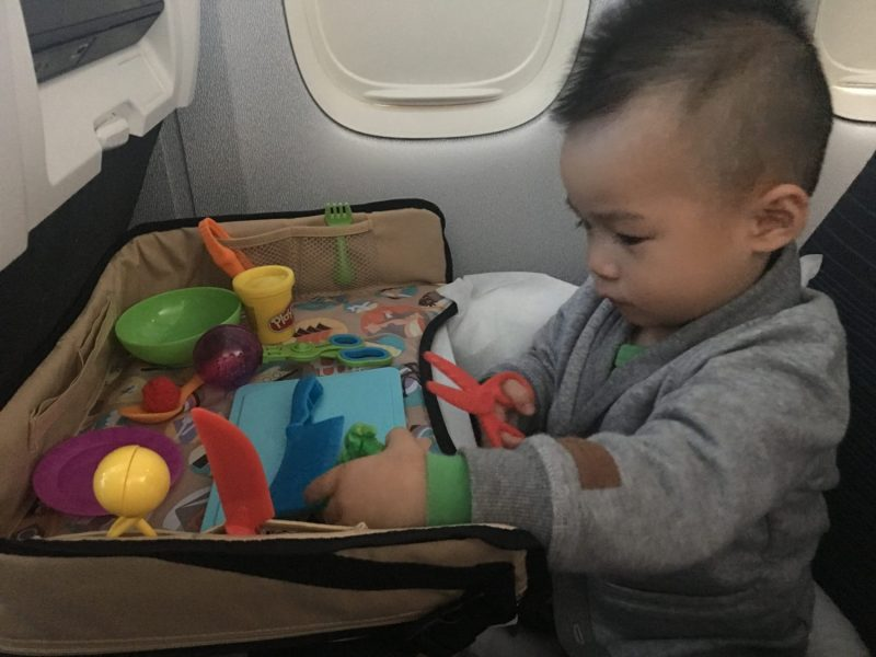 car seat travel tray keeps the little bits from rolling off the table