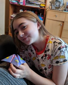A girl playing with a paper fortune teller