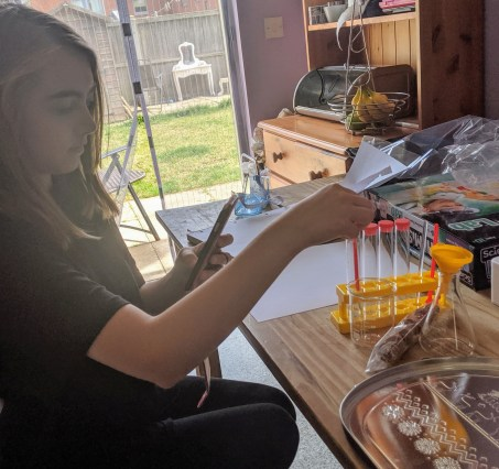 Young girl doing experiments with a chemistry set