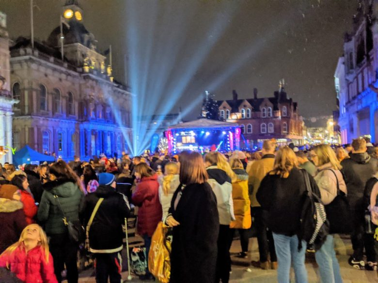 Many people gathered together at night in the town centre