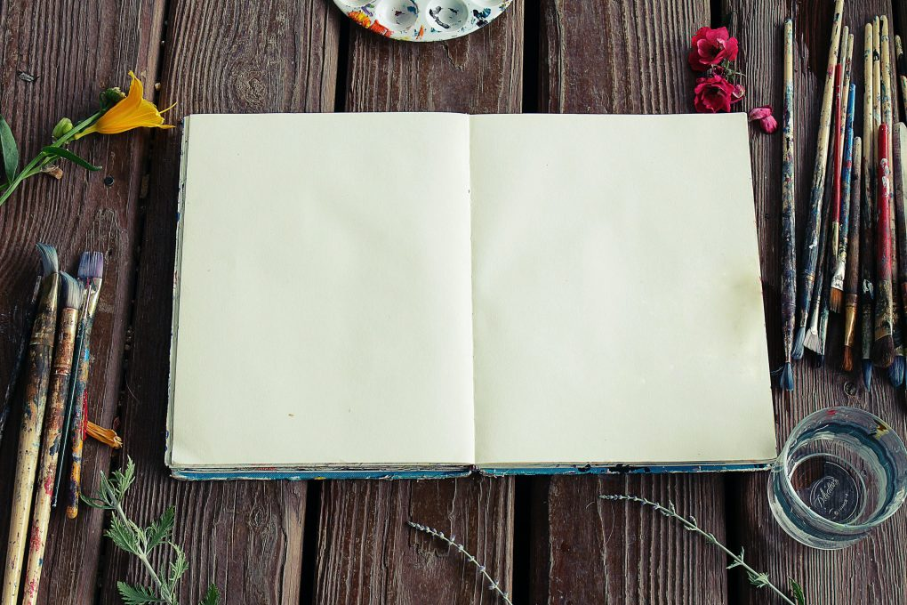 Blank book with paint brushes ready for a family activity